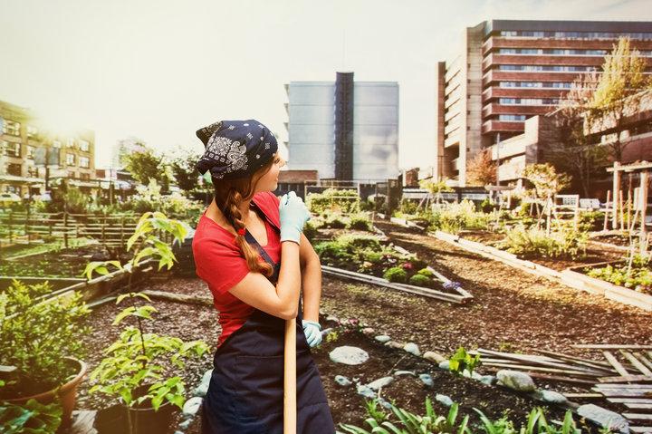 Female gardener in garden & looking awayhttp://www.twodozendesign.info/i/1.png